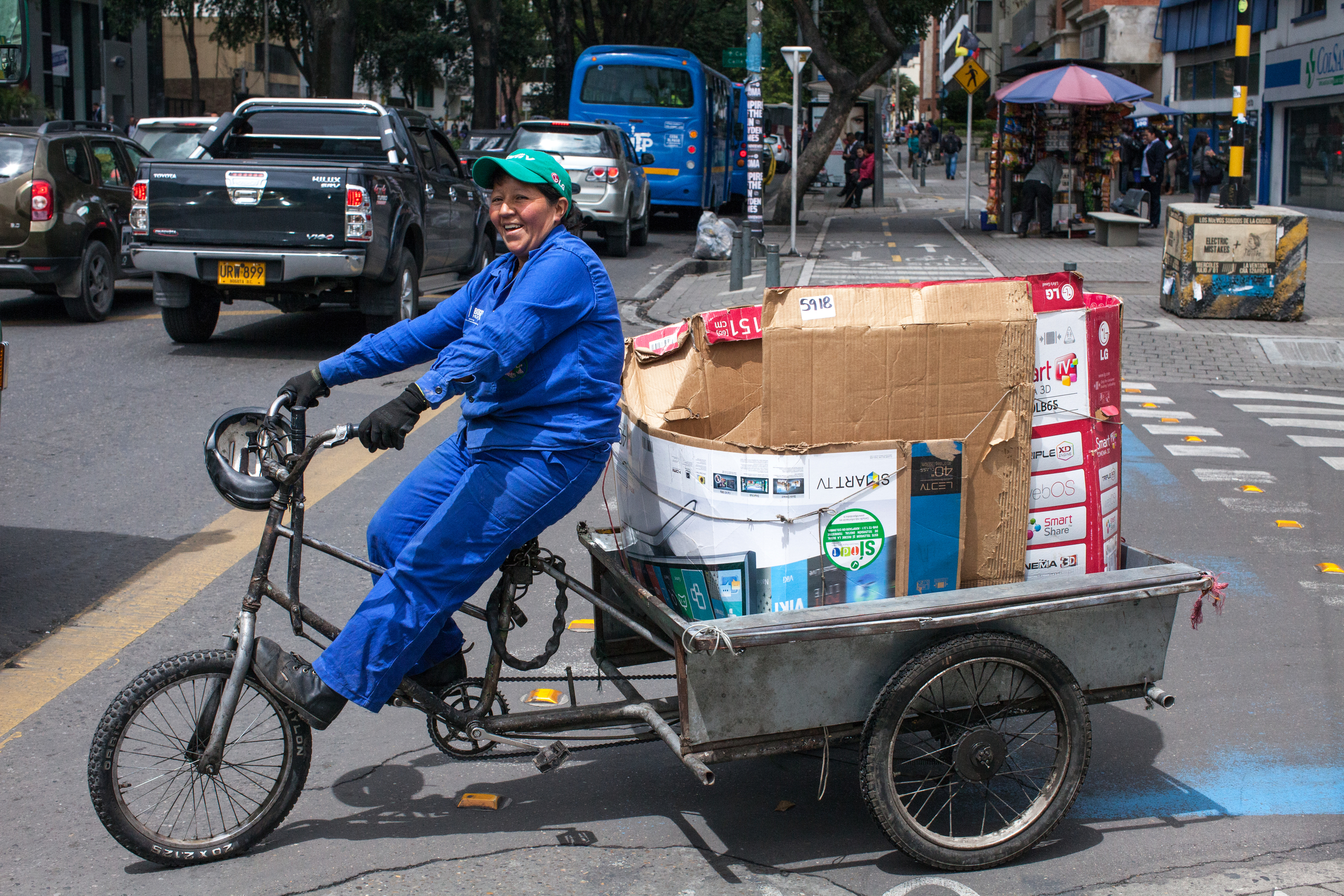 <p>Sonia Janeth Barriga, a waste picker member of Asochapinero—an affiliate of the Asociación de Recicladores de Bogotá (ARB), an organization of waste pickers' associations and cooperatives that advocates for waste pickers\' rights—transports recyclable materials with a tricycle. In this neighbourhood, Chapinero, she has negotiated with building administrators, neighbours, and hotel managers to be able to collect their recyclables. Being part of an organization has been instrumental to her success in these negotiations.  (Photo by Juan Arredondo/Reportage by Getty Images).</p>
