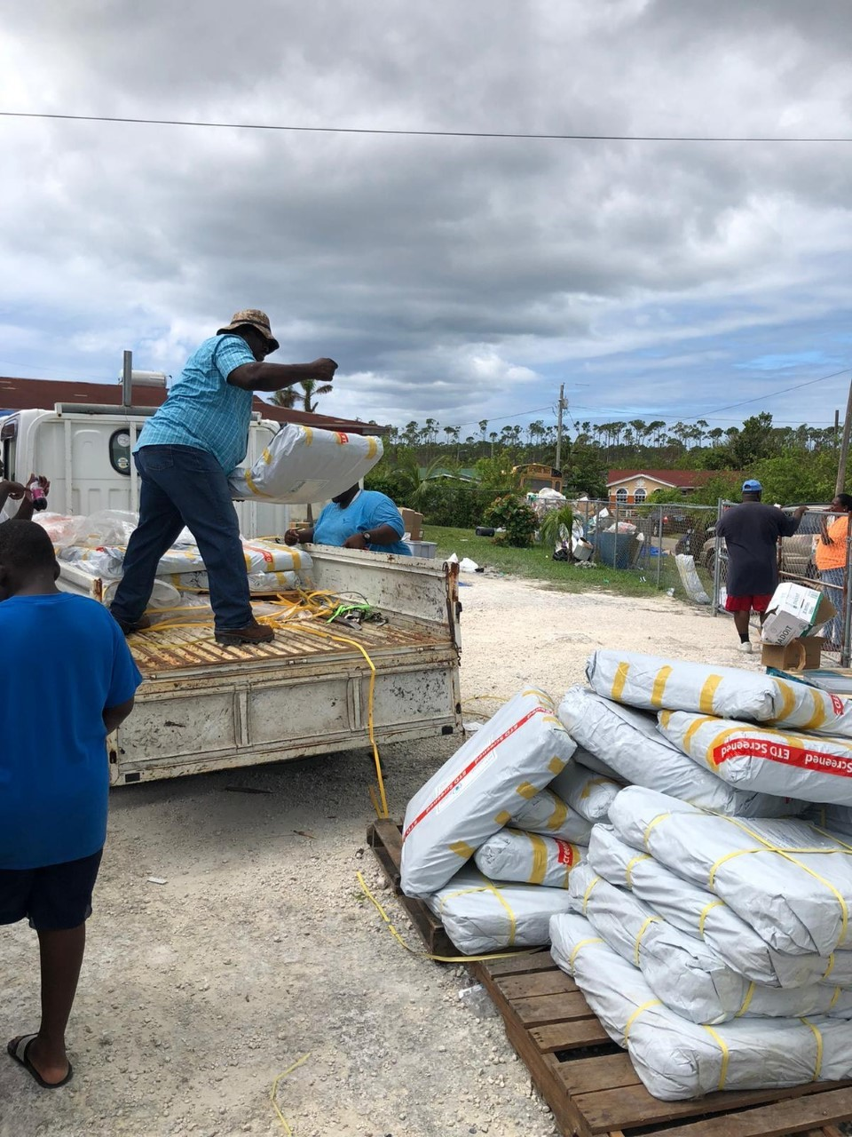 <p>Local responders distribute supplies in the Bahamas after Hurricane Dorian. Photo by Jerry Christopher Butler.</p>