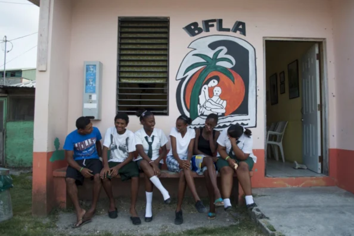 <p>Young people outside a sexual and reproductive health clinic in Belize City. Making clinics resilient to disasters should be a priority. Photo by Erika Morillo/IPPF/WHR/Clara Lionel Foundation.</p>