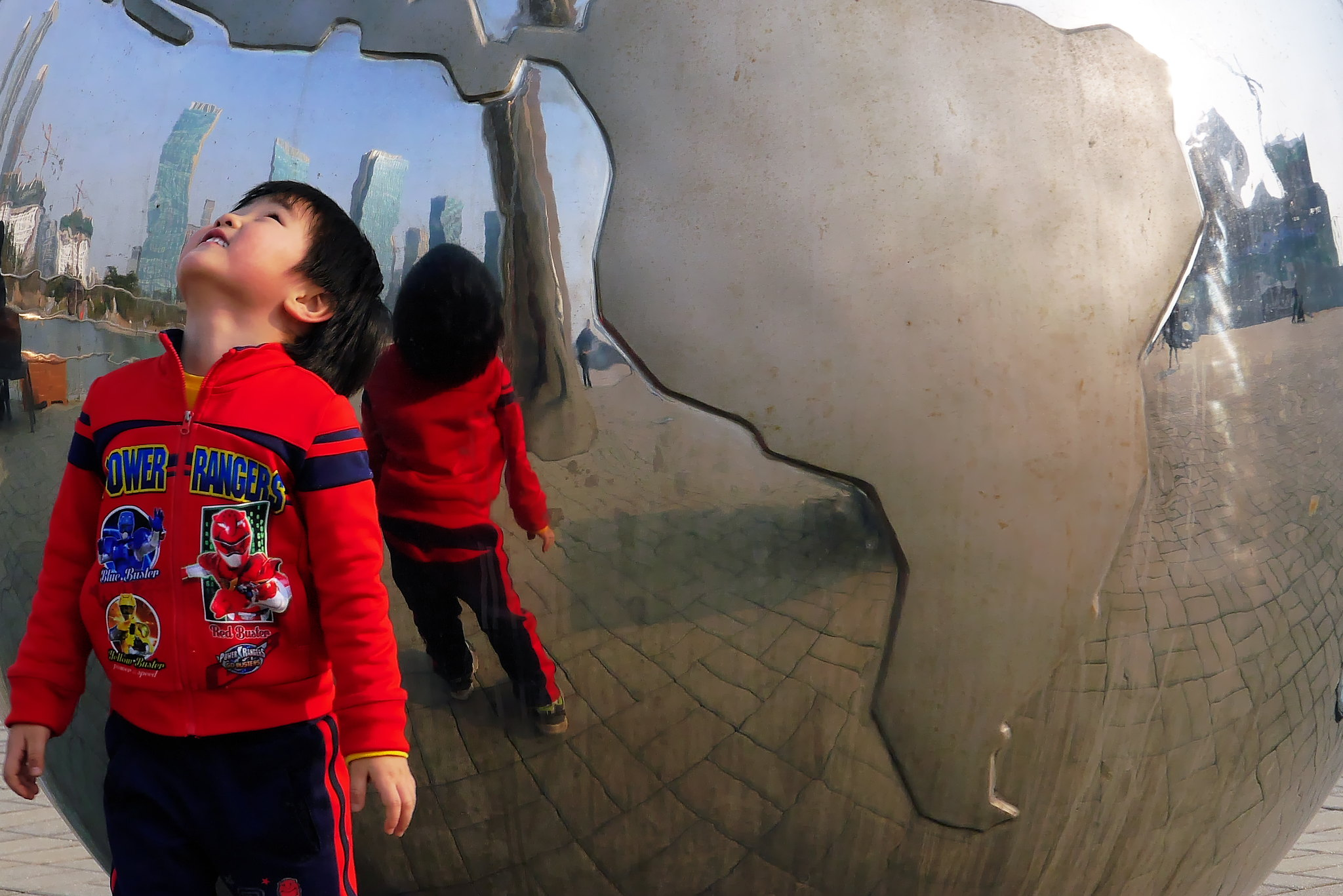 <p>A child looks up at a globe in Incheon, South Korea. Photo by travel oriented/Flickr.</p>