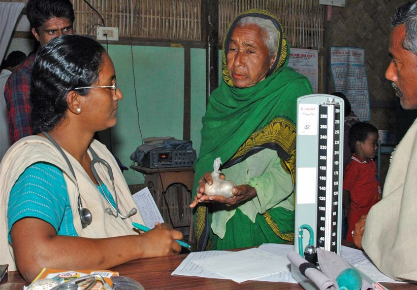 <p>Dr. Ann Miriam with a patient who could only afford eggs as payment. Many rural hospitals in poor communities operate as nonprofits. Photo by Makunda Hospital</p>