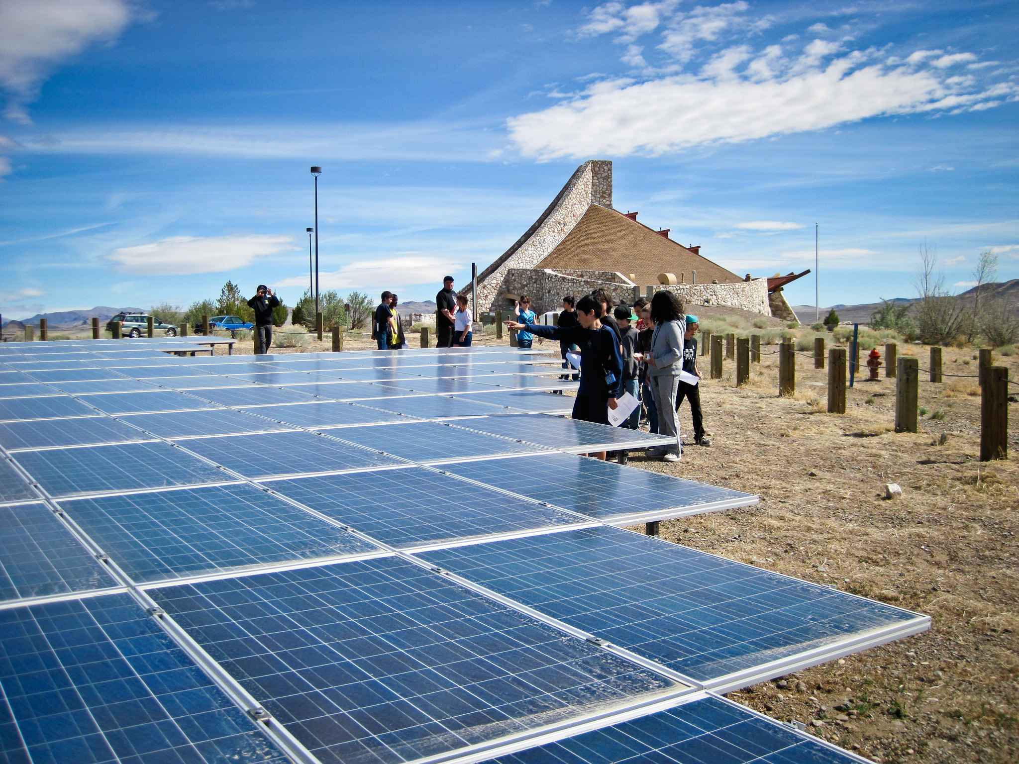 <p>High school students in Nevada discuss the solar array at their school. Photo by Black Rock Solar.</p>