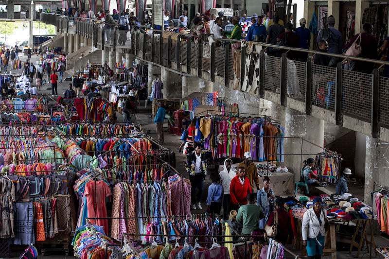 <p>Between 6,000 and 9,000 informal vendors ply their wares at the markets in Warwick Junction. Photo by Jonathan Torgovnik/Amend</p>