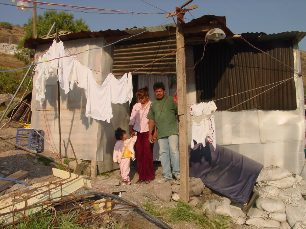 <p>Homes like this one in a community called \'La Petrolera\' are often overcrowded, unstable and made of dangerous materials. They provide stark visual evidence of Mexico's severe housing shortage. Photo credit: Échale</p>
