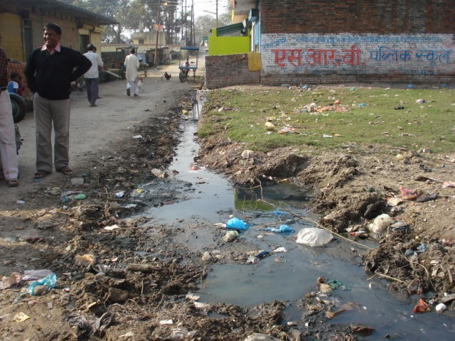 <p>Waste collects in stagnant water in a neighborhood in Gorakhpur. Photo credit: GEAG</p>