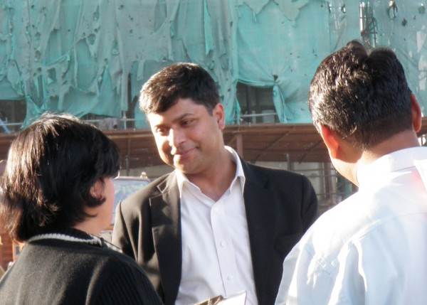 <p>Ritwick Dutta with clients outside the courthouse</p>