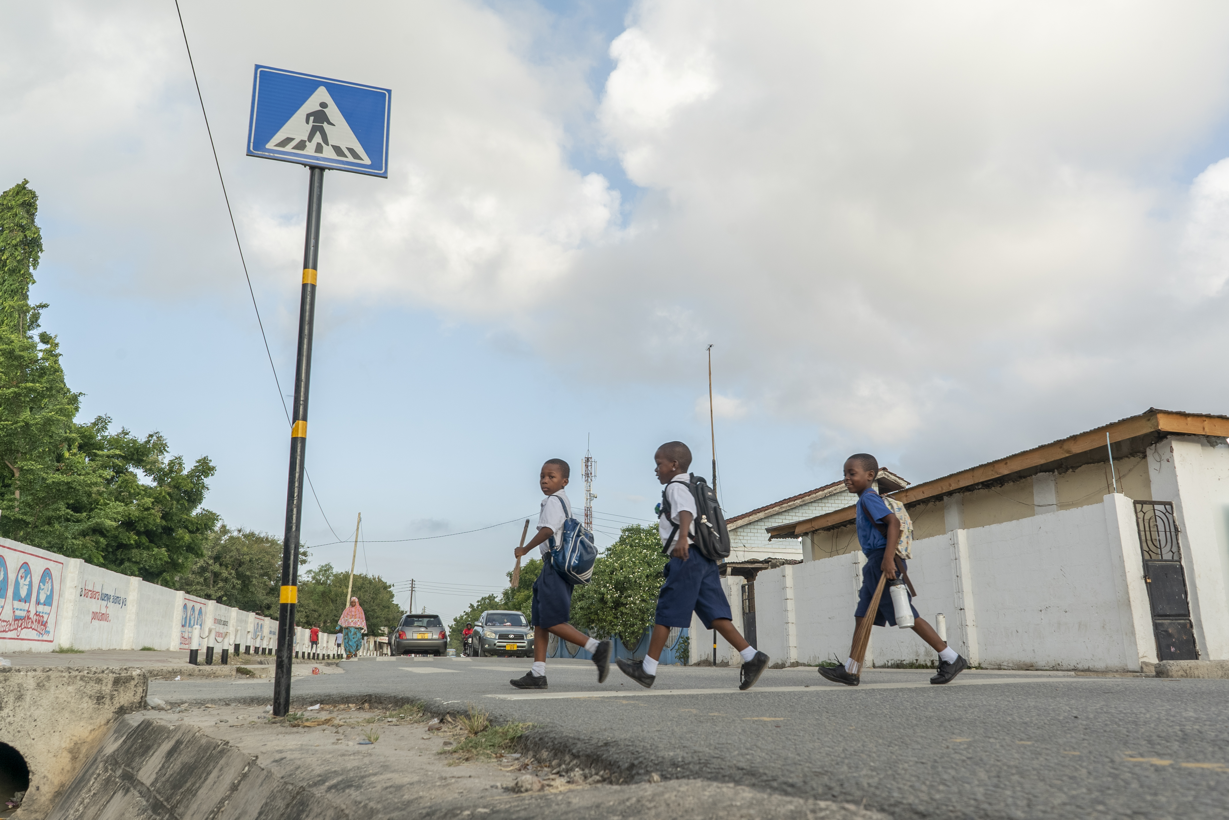 <p>Children in sub-Saharan African are twice as likely to die in a road crash than kids in other parts of the world. Designated crossings like the one above help make students\' walks to school safer. Photo by Kyle Laferriere</p>