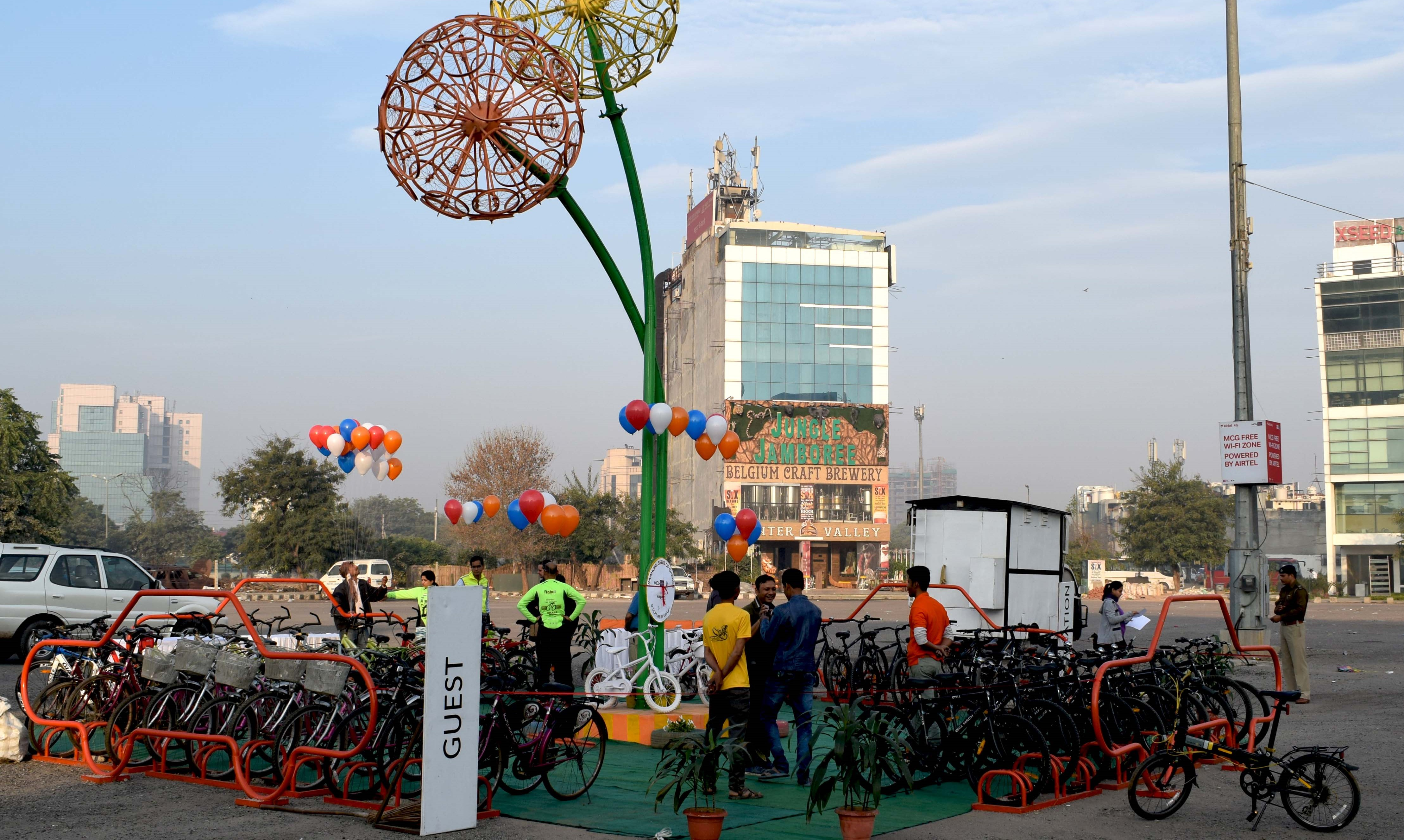 <p>The Seeds for Change project in Gurugram, India, reclaimed four car parking spots to make space for 40 bicycles. Photo by Amit Bhatt/WRI</p>