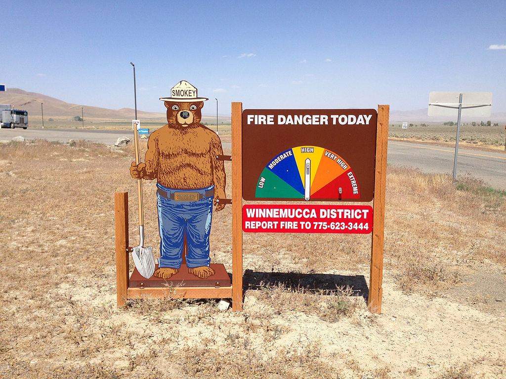 <p>Smokey the Bear fire danger sign in Paradise Valley, Nevada. Photo by Famartin/Wikimedia Commons</p>