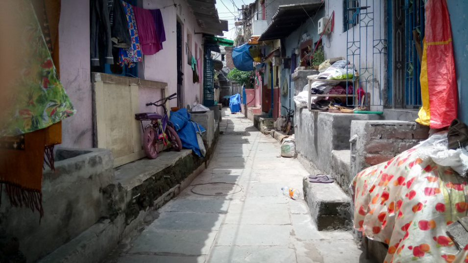 <p>Residents have built high plinths to raise their homes above street level and taller thresholds at their doorways to prevent storm water from entering homes. Photo by Lubaina Rangwala/WRI</p>