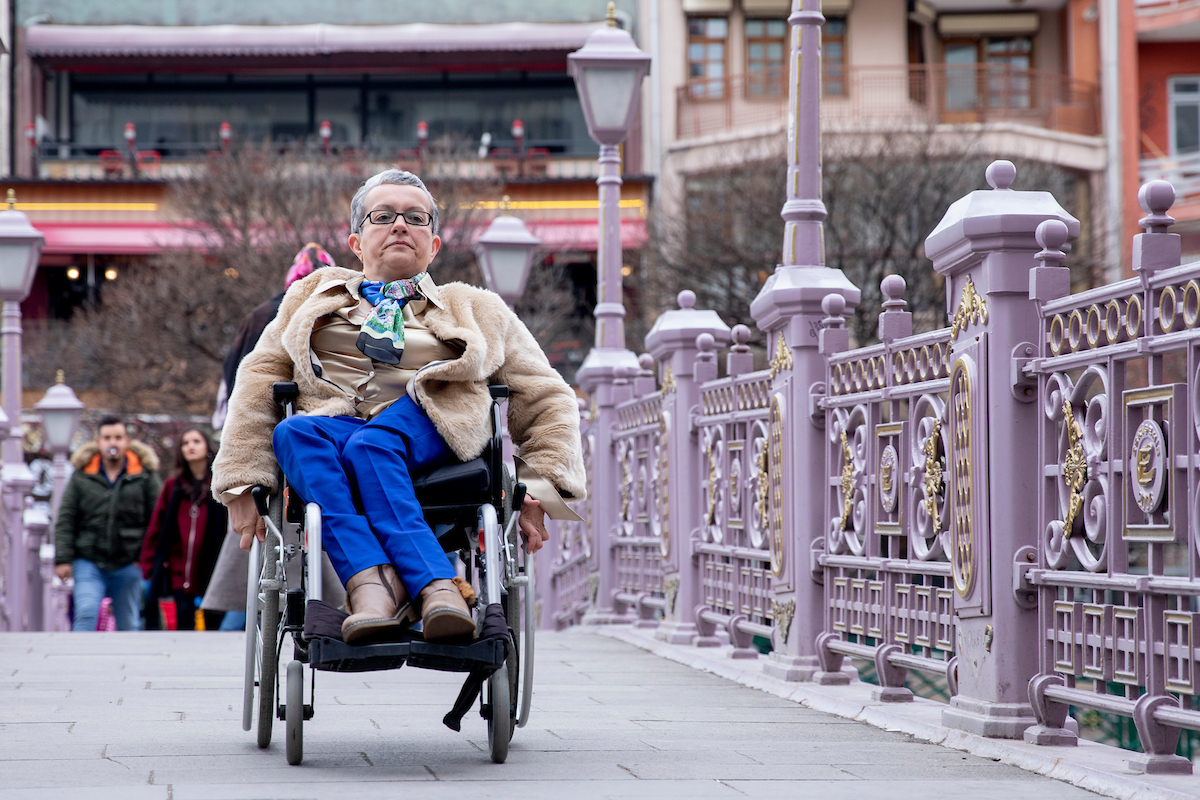 <p>Emel Kapanoğlu, an advocate for people with special mobility needs, finds Eskişehir easier to navigate via wheelchair after upgrades to streets, bridges and public transport. Photo by Kyle LaFerriere</p>